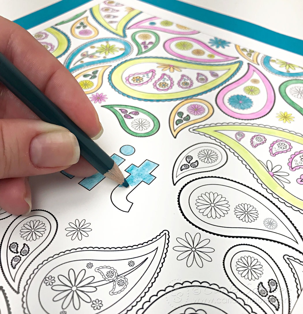 Coloring a cuss word coloring page with colored pencil