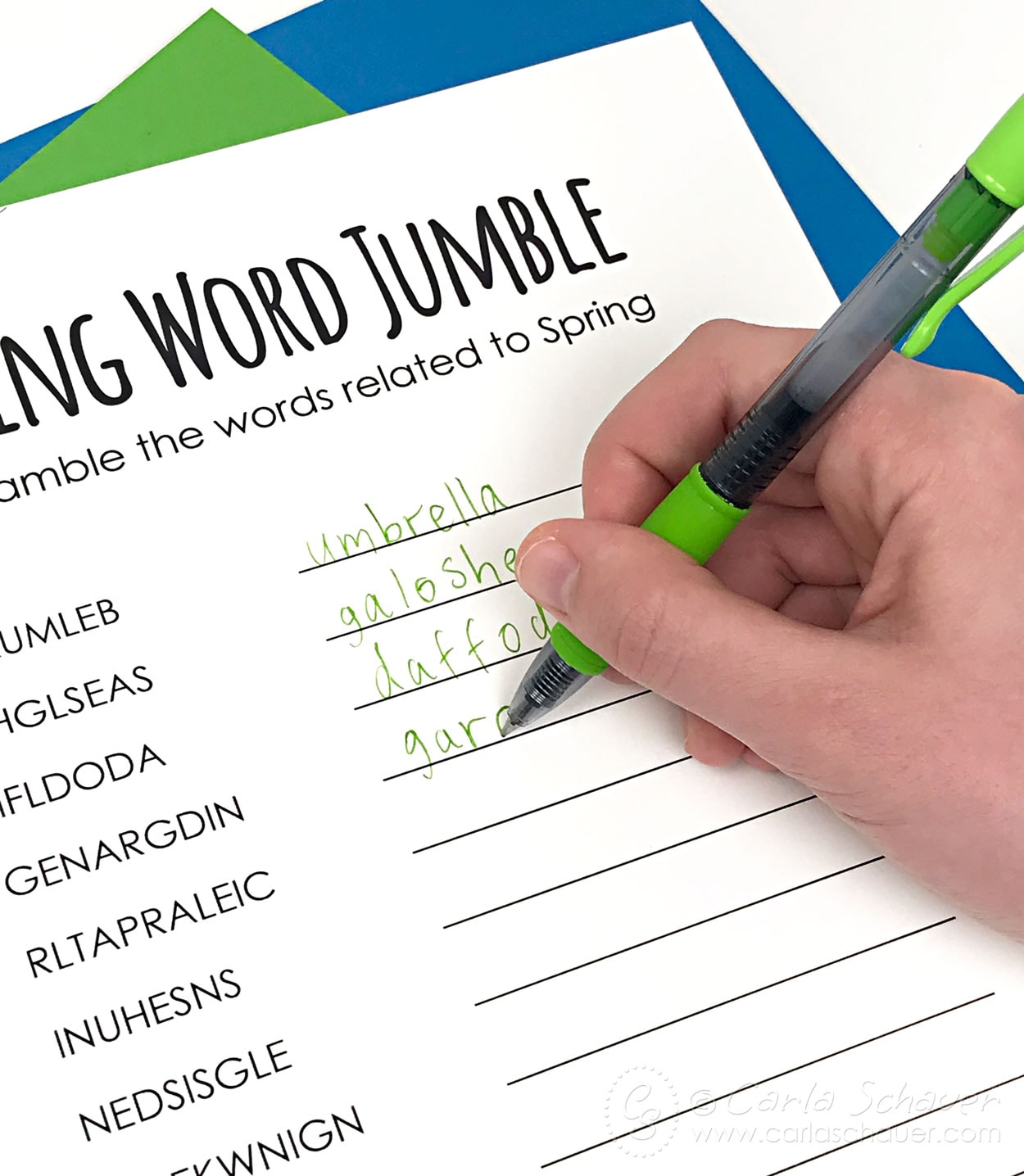 Writing words on spring word puzzle with green pen