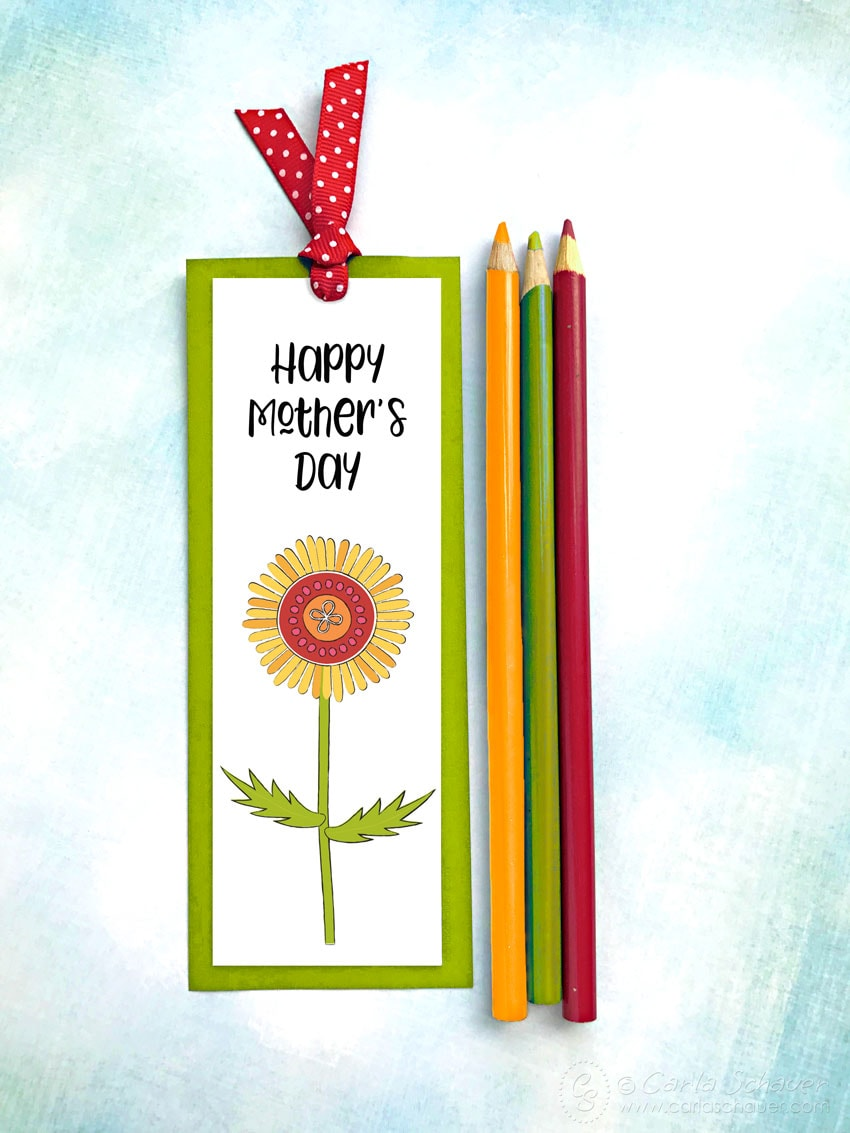 Happy Mother's Day bookmark with flower on blue background