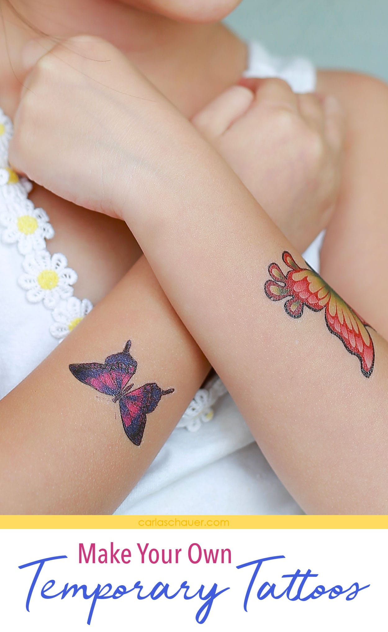 Colorful temporary tattoos on child's crossed arms.