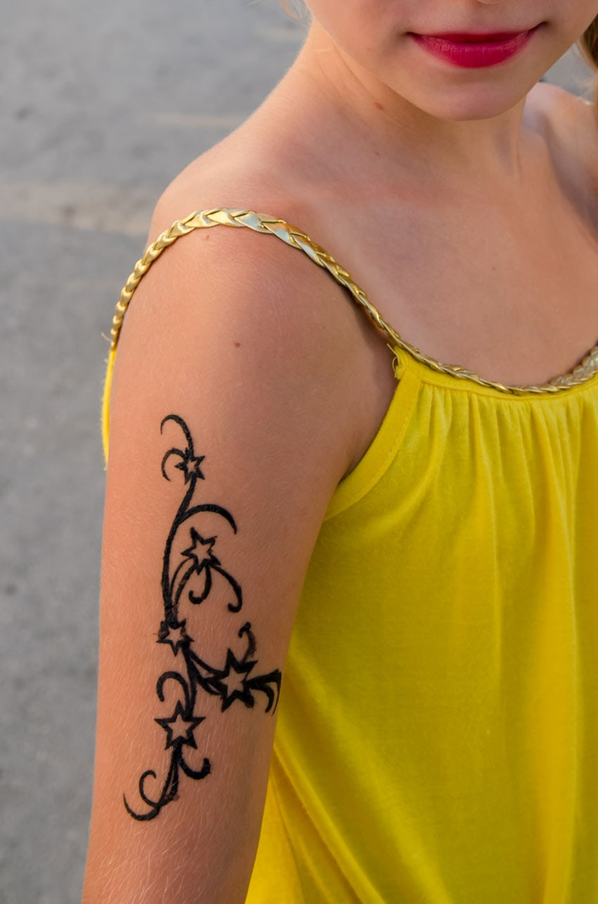 Temporary Star Tattoo on girl's shoulder.