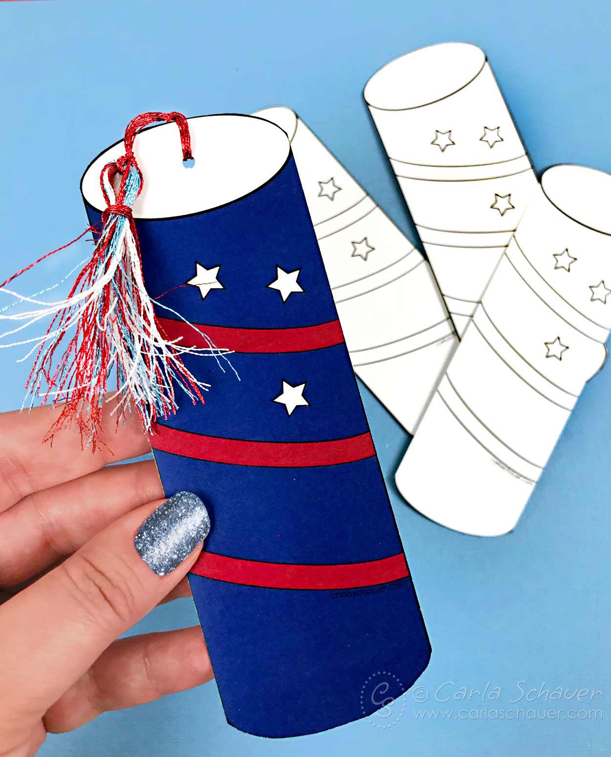 Hand holding firecracker patriotic bookmark.