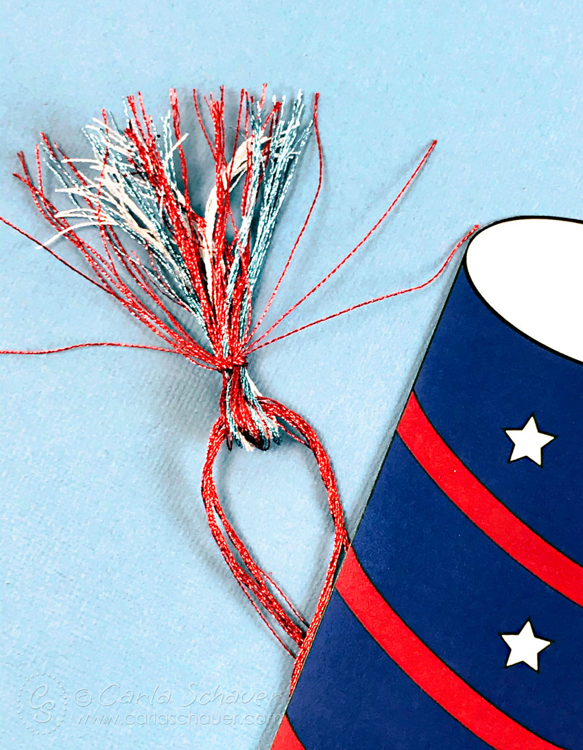 Red, white, and blue metallic embroidery floss tassel.