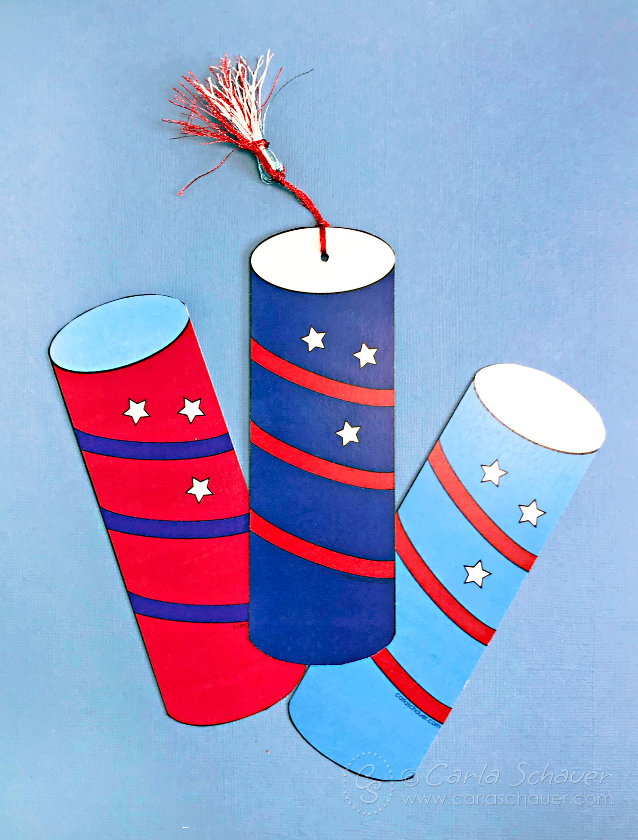 Three fully colored patriotic firecracker printable bookmarks.