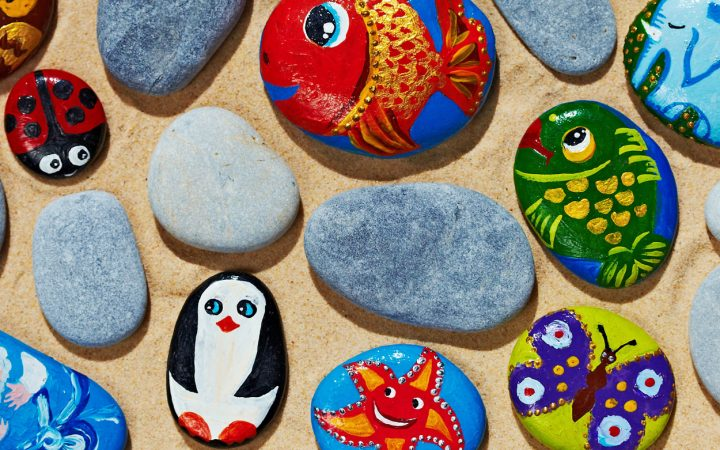 A mix of animal painted and unpainted flat stones.